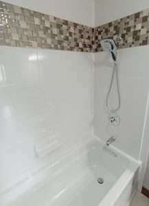 white and brown tile shower